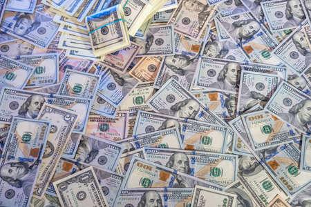 Pile of $ 100 dollar bills for background.