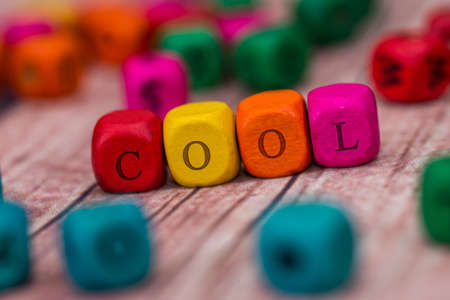 cool - word created with colored wooden cubes on desk. Reklamní fotografie