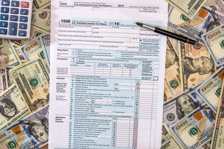 2017 tax from 1040 with dollar and calculator