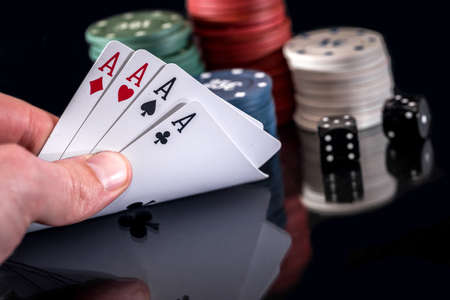 poker chips and play card isolated on black