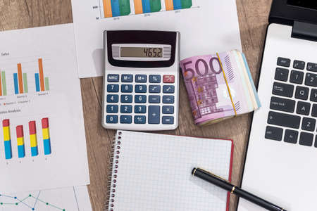 business concept - euro, laptop, calculator and notepad