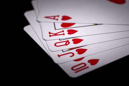 Royal flush. Playing cards isolated on black background