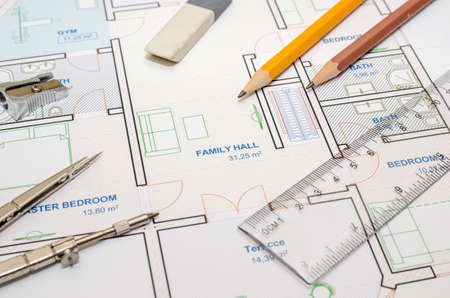 house floor plan with drawing compass and pencil