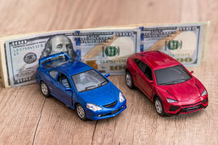 toy cars and dollar on desk