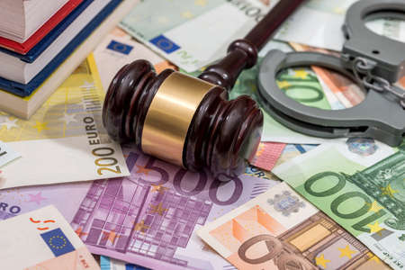 handcuffs with hammer of judge and euro. business concept Imagens
