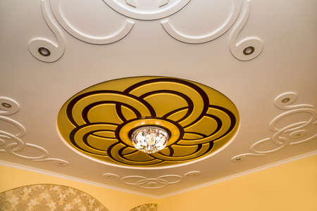 Part of the room - glossy ceiling and chandelier