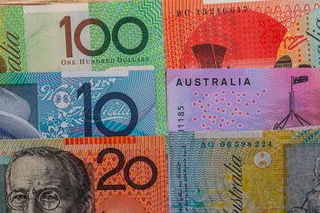 Australian dollar banknotes lied down on table, close up