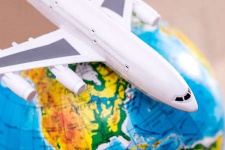 airplane on the background of the globe