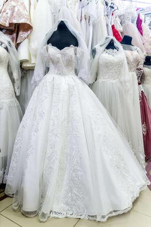 Dresses for bride in wedding salon on mannequins