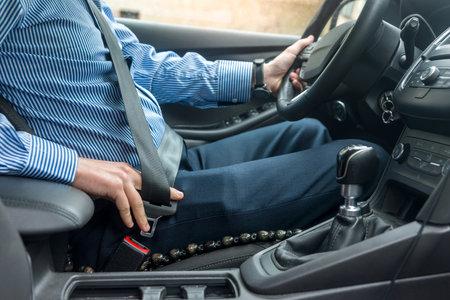 Male hands locking up safety belt, close up