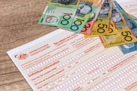 Australian taxation company, individual form with aud banknotes