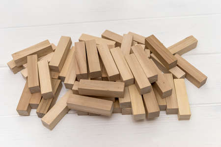 Wooden blocks for tower building on the desk