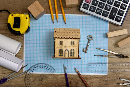 Drawing paper with house model and different tools