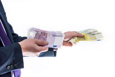 Male hand pulling up euro banknotes from pile