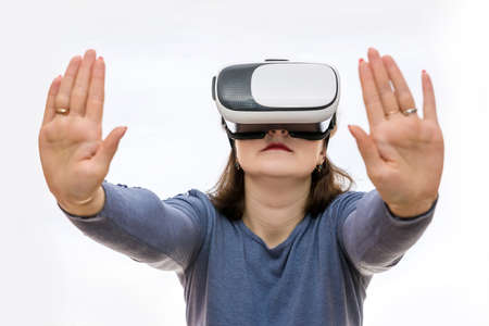 Woman in virtual glasses holding something with hands