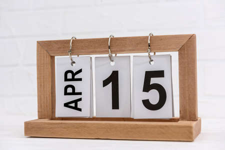 Wooden calendar with date 15th of April, Tax day