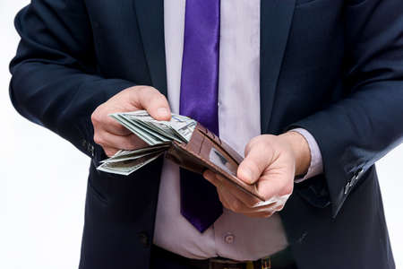 Man showing wallet with dollar banknotes on white background