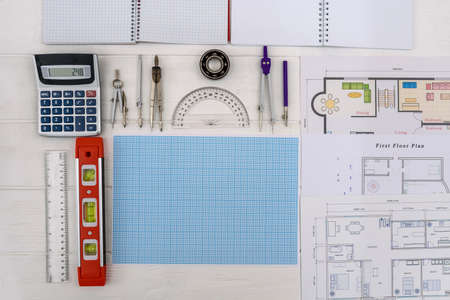 House plans with millimeter paper and drawing tools