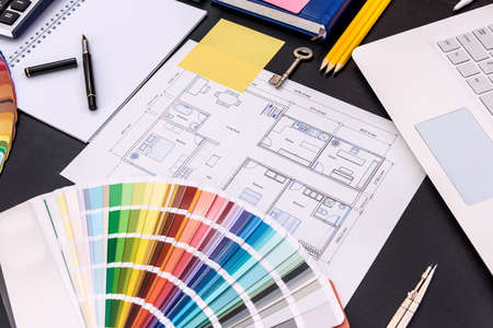 Color swatch with architectural drawing on table Archivio Fotografico