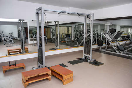 Modern and empty gym interior with equipment Stock Photo