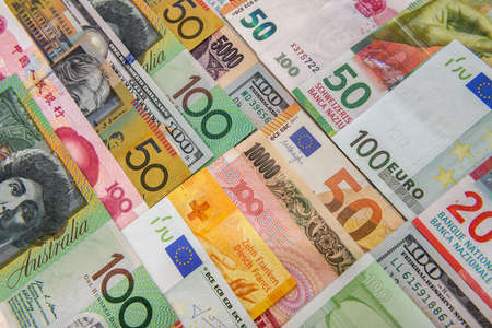 Colorful banknotes of different countries as background close up