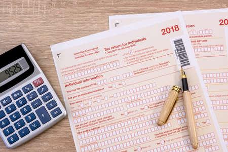 Australian tax declaration and pen on wooden table