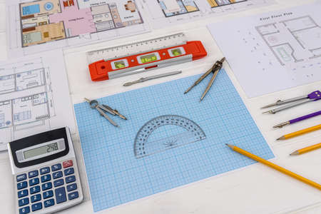 Drawing tools with house projects and millimeter paper Standard-Bild