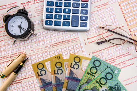 Australian tax declaration as background for calculator and dollars