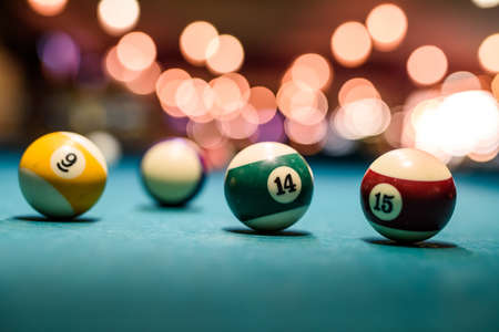 Colorful billiard balls on table close up 免版税图像