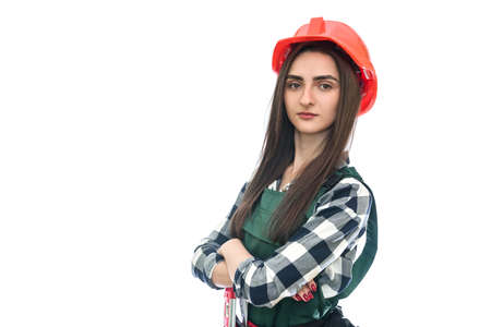 Young woman in coverall isolated on white 免版税图像