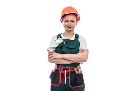 Young woman in helmet holding roller isolated on white