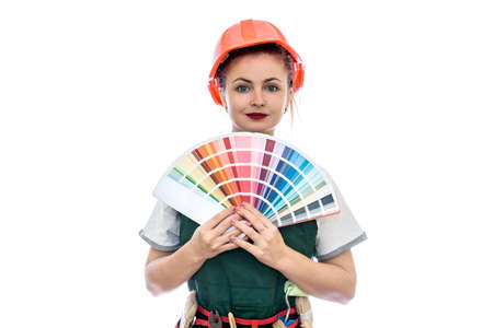 Beautiful woman in coverall with tools and color swatch 免版税图像