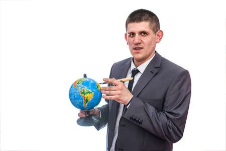 Man in suit with globe isolated on white