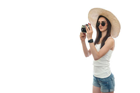 Woman tourist taking photo isolated on white 免版税图像