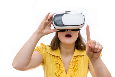 Woman shows gestures in glasses of virtual reality in her hands, isolated on white background