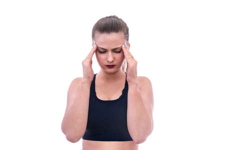Woman holding her head with hands, headache