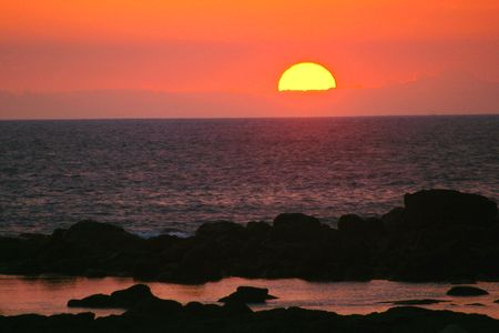 Sunset at a Lava Rock Beach photo