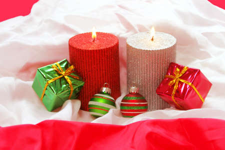 Christmas Candles, Ornaments and Gifts on Fabric photo