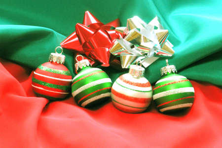 Christmas Ornaments and Bows on Fabric photo