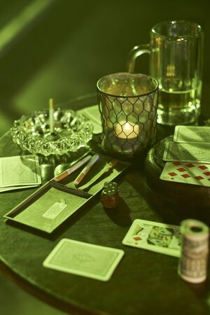 Gambling, tobacco and drinks on table