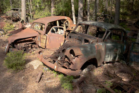 Car wrecks in the woods Stock Photo