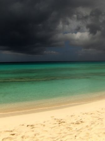 foreshadowing: Stormy sky darkens the ocean turning it black