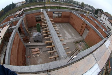 New house under construction with wooden and iron equipments photo