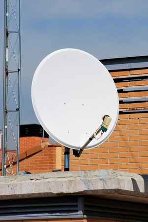 Parabolic antenna. Equipment for receiving digital data from satellites Stock Photo - 4509704