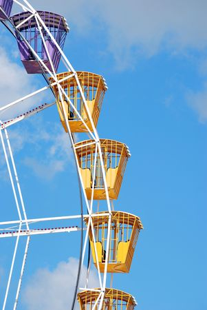 clody: Ferris Wheel in a clody sky. Attraction in a park Stock Photo