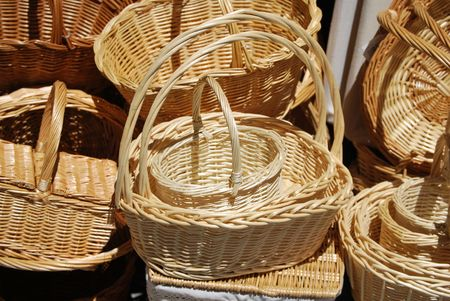 Hand made wicker baskets stacked in the shop photo