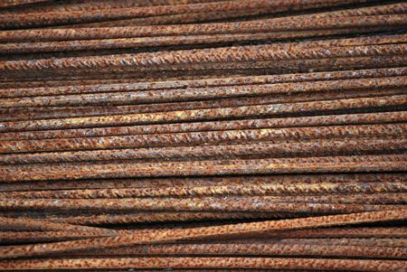steely: Several rusty iron rods.