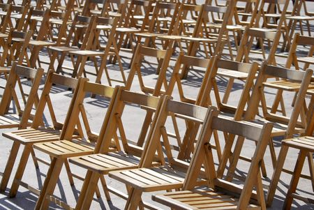 Wooden chairs in the street ready for the show photo