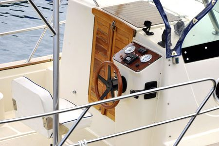 Moder helm of a recreational boat. Nautical concept photo