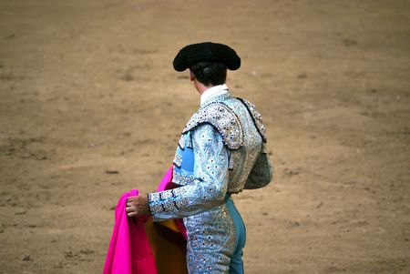 bullfighter waiting with their hands in the cape photo